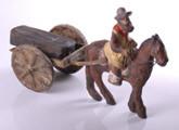 Carro de juguete tirado por caballo y jinete