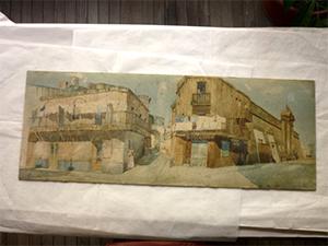 """Desmontaje de la acuarela """"La ciudadela de Montevideo"""" de Pedro Figari para el reenmarcado museológico."""